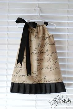 DIY/Tutorial..Pillowcase Dresses...great sewing project for a beginner, especially if you want to make something really cute for a child. If you don't have a pilllowcase with writing on it, use a fabric marker and design your own pattern!
