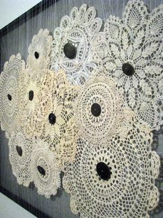 Doily wall art. Instead of the black you could put multiple pearls to make it more fancy. :)