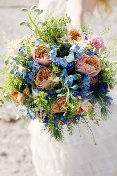 Vintage Pretty Seaside Wedding Ideas Vintage Bridal Bouquet Wild Blue Peach Coral Green http://www.jobradbury.co.uk/