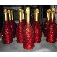 Champagne bottle. Spray painted gold with red glitter. Hollywood baby shower.