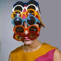 Sixties Fashion - a young female model wears multiple versions of differently coloured sunglasses on her head to cover her face and forehead and pink hat in Get premium, high resolution news photos at Getty Images Sol Meme, Cat Eye Colors, Sixties Fashion, Bizarre, Young Female, Sunglass Frames, Photo Instagram, Mellow Yellow, Looks Cool