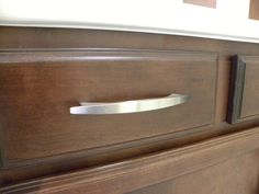 Oversized Brushed Nickel Cabinet Hardware Is Standard And Makes For Easier Operation Than Smaller Pulls Or