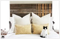 A fence turned into a great rustic headboard with gold racing stripes. #DIY #headboard