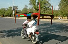 ISLAMABAD: A man hold charpoy while sit on motorbike in Federal Capital.