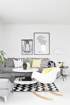 White and grey living room with pops of pepper & lemon and use of geometric patterns to add character and personality.