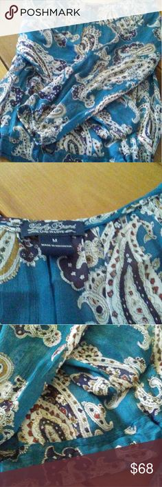 Lucky Brand Peasant Top Turquoise, purple & gold print peasant style top. Bloused & ties at one side of hip. Long flowy sleeves. Sheer fabric suggest wearing a camisole underneath. Look so cool with your fave Lucky jeans! EUC. Lucky Brand Tops Blouses