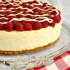 White Chocolate Cheesecake with Raspberries - just one of the decadent  cheesecake inspired recipes on our indulgent Cheesecake Board. ...AND there's an incredibly luscious new cheesecake recipe coming this weekend that you definitely will NOT want to miss.