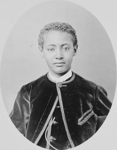 1873 - Photograph of Prince Alamayou of Abyssinia, facing the viewer in head and shoulders length. The Prince wears a velvet jacket and matching waistcoat.