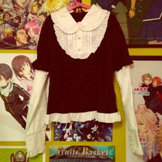 """Gothic Lolita Harajuku Visual Kei Japanese Top  Super Kawaii top by the brand """"Body Line""""  Has lace detail and cute heart button all over, on the cuffs, up and down the sleeves, on the collar, and has ruffling on the hem of the shirt ☺️ Super cute and perfect for cosplay or casual Lolita  Never worn by me, worn very lightly by the previous owner  Tagged as a size Medium, however I would say runs small.  Hot Topic Tops Blouses"""