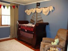 Inspired Monday: Baby Boy Nursery Ideas. Sail on wall..could work for any sleigh bed or sliegh crib against the wall