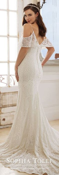 Wedding Dress by Sophia Tolli | Fabulously on-trend, Rhea is a lace over stretch jersey sheath with a cold shoulder ruffled neckline, beaded spaghetti straps, princess line lace trim, a V-bac, a scalloped lace hem and a chapel train. #weddingdress #weddingdresses #bridalgown #bridal #bridalgowns #weddinggown #bridetobe #weddings #bride #weddinginspiration #weddingideas #bridalcollection #bridaldress #fashion #dress See more gorgeous bridal gowns by clicking on the photo