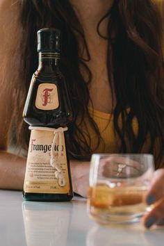 What is frangelico and what do you do with it? Learn what it tastes like and some drink recipe ideas. Whiskey Sour, Whiskey Drinks, Whiskey Bottle, Dessert Drinks, Yummy Drinks, New Drink Recipe, Wafer Cookies, Vanilla Cream, Cocktail Making