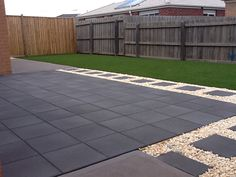 Charcoal pavers, white pebble and artificial turf. Done by Exseed Landscaping in Truganina.