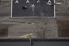 Authorities stand at the seawall along the start of a runway where an Asiana Airlines Boeing 777 plane crashed while landing at San Francisco International Airport, on July 6, 2013. (Reuters/Jed Jacobsohn)