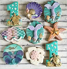 Under the sea theme sweets for the talented mermaid tail cookie inspired by Iced Cookies, Fun Cookies, Cupcake Cookies, Cookie Frosting, Little Mermaid Cupcakes, Mermaid Cookies, Candy Table Decorations, Mermaid Birthday, Princess Birthday
