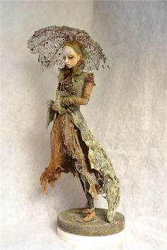 love this sort of nature tattered look to this art doll