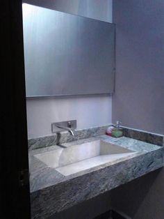 Lavabo de marmol forrest green con onix y espejo flotado