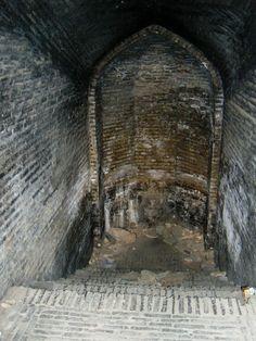 Entrance to an underground cistern below the Zoroastrian Tower of Silence, near Yazd