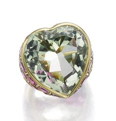 GREEN BERYL AND RUBY RING, SUZANNE BELPERRON, CIRCA 1960.  Set to the centre with a heart-shaped green beryl, surrounded to the front with circular-cut rubies