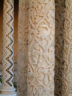 Intricately carved columns at Monreale Cathedral (Palermo, Sicily) - relief carvings of foliage, animals, birds and Zodiac signs.