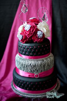 Hot pink and zebra wedding cake i don't like the flowers on top but the rest is pretty!