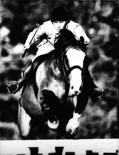 Photographer/Creator  Lowell Georgia  Collection  1960  Publisher  Denver Post  Caption/Description  Horse and rider heading towards a hurdle.