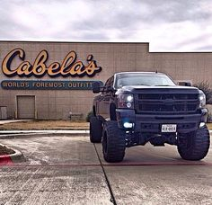 Lifted Chevy and cabelas back ground...didn't know you could put so much awesome in one picture