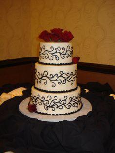 black scrolls wedding cake