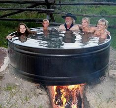 Redneck hot tub.  I sure hope my husband doesn't see this