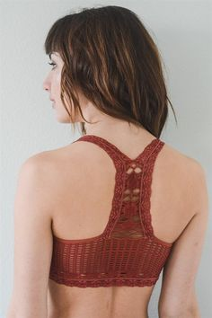 Carefree Crochet Bralette - Livin' Freely This Carefree Crochet Bralette features a racerback with crochet-like detail and lace trim and straps, making it perfect for layering. It comes in the color Marsala.