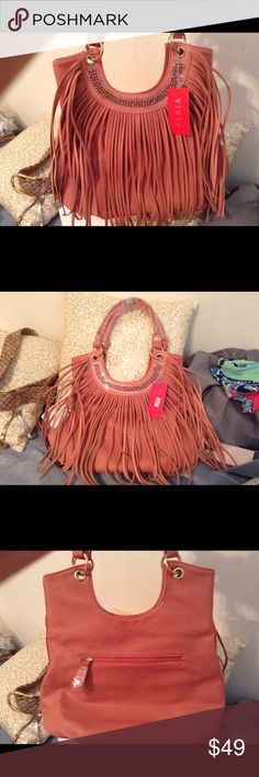 Beautiful,Pink Fringe Bag! NWT This Is A Gorgeous Shoulder Bag That I Purchased From Another Posher And Have Never Used ! Beautiful Pink Color And Is In New Excellent Undamaged Condition! Just A Fun Lovely Bag With Beautiful Clear Stones Around The Top Also Lots Of Room Inside The Bag! Thanks!🎀24 HOUR SALE🎀 Vieta Bags Shoulder Bags
