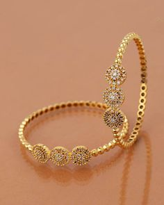 Coin Jewelry Inspired Studded Bangles Bracelet - Shop exclusive online collection of for Women at VOYLLA. Choose from collection of gold, copper, & charm bracelets at ✓Best Prices ✓COD ✓Easy Returns Bracelets Design, Gold Bangles Design, Gold Earrings Designs, Gold Jewellery Design, Necklace Designs, Charm Bracelets, Gold Bracelets, Silver Bangle Bracelets, Antique Jewellery