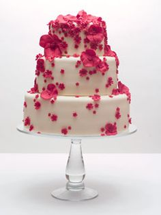 Pink blossom cake. For my wedding I would want flowers in our favorite colors, blue and green.