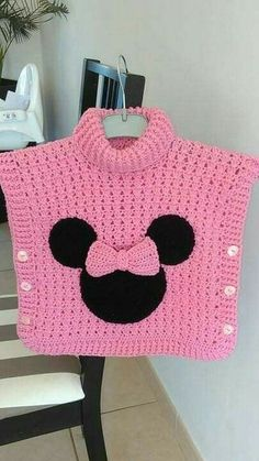 un joli poncho Minnie au crochet – La Grenouille Tricote - knitting for babies Crochet Baby Poncho, Crochet Poncho Patterns, Baby Girl Crochet, Crochet Baby Clothes, Cute Crochet, Baby Knitting Patterns, Crochet For Kids, Knit Crochet, Crochet Hats
