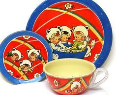 Girls dressed a kittens on this 1930s-1940s Art Deco tin tea toy set by Ohio Art.  3 pieces include a plate, cup & saucer.  Cup is 1 tall & 2 1/8