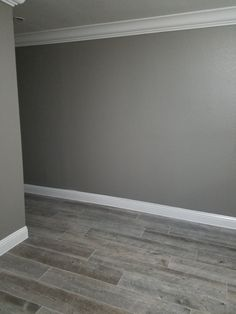 Walls: Acier SW9170 Floors: Natural Timber Ash Porcelain Tile (Lowe's)