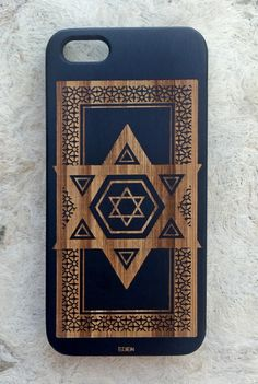 Black Wood Star of David Phone Case.This laser engraved wooden phone case features the Star of David, decorated with intricate ornamental details. | edencases.com