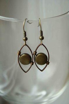 Wire Wrapped Earrings Brass Copper Beaded. $14.00, via Etsy.