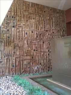 One of a pair of enormous wall relief pieces; unglazed clay—color is provided by colored glass melted into depressions.  This installation is in an out-of-the-way, all but forgotten location—an apartment tower above the Sunset Strip.  Stan Bitters, California