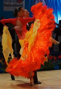 Name & Location unknown | WDSF 2014 [love the fiery color combo and sleeve design]