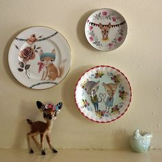 Three plates and a deer