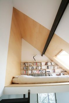Tiny House Sleeping Loft with Books, Shelves and Skylight