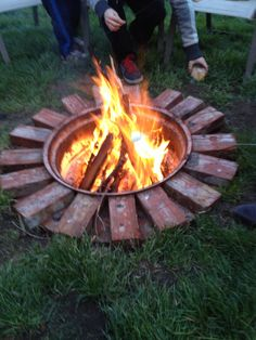 DIY fire pit. Dig a hole, burry a tire rim, decorate with bricks. So easy and basically free!!!