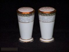 Noritake Langsdale #4785 Salt & Pepper by Noritake Bone China. $19.49. Dimensions: N\A. Brand New - First Quality. Salt & Pepper - White Floral Scrolls On Rim - Multi-Color Outer Band - Wide Gold Trim - Made In Japan