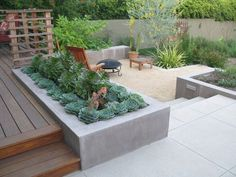 '900 House' brings us this contemporary garden. Built-in planter separates different areas of the deck and patio.
