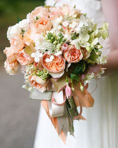 a bouquet of garden roses, fuchsias, hydrangea, phalaenopsis orchids, and foxglove. Its mix of blooms and various cascading ribbons brought together the Marie Antoinette-inspired pastel palette and feminine vibe.