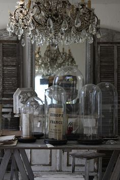 glass #cloches and chandelier...