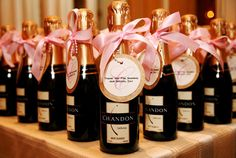 champagne wedding favors---these wouldn't make it past my ladies in red putting them on the table! :)