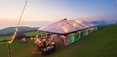Kahua Ranch - Hawaii Venues - Outdoor sunset wedding reception with neon lights