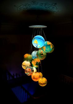 """Beautiful """"chandelier"""" made of 15 world globes. I've searched everywhere even for single glowing globe! Desk Globe, Globe Lamps, Globe Chandelier, Globe Lights, Chandelier Lighting, Light Globes, Chandeliers, Globe Art, Solar System Chandelier"""